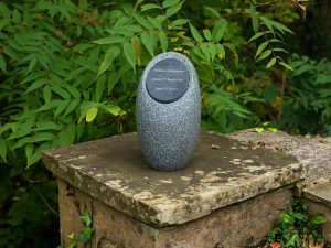 A moulded pod with inlaid dark slate plaque