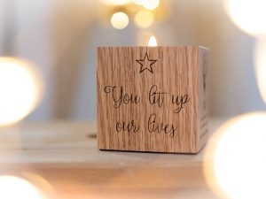 Solid oak engravable cube with small glass jar to keep mementos or ashes in with a candle holder on top